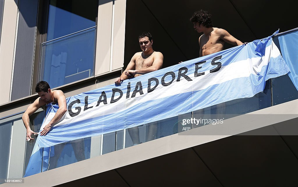 olympians-from-argentina-hang-a-banner-o