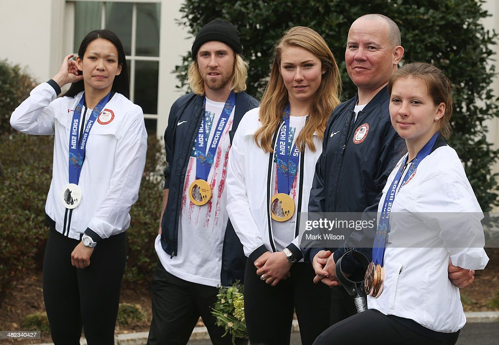 U.S. Olympians <a gi-track='captionPersonalityLinkClicked' href=/galleries/search?phrase=Julie+Chu&family=editorial&specificpeople=677214 ng-click='$event.stopPropagation()'>Julie Chu</a>, Sage Kostenberg, <a gi-track='captionPersonalityLinkClicked' href=/galleries/search?phrase=Mikaela+Shiffrin&family=editorial&specificpeople=7472698 ng-click='$event.stopPropagation()'>Mikaela Shiffrin</a> and U.S. Paralympians Jon Lujan and <a gi-track='captionPersonalityLinkClicked' href=/galleries/search?phrase=Stephanie+Jallen&family=editorial&specificpeople=5784669 ng-click='$event.stopPropagation()'>Stephanie Jallen</a> stand together while speaking to the media in front of the West Wing while visiting the White House on April 3, 3014 in Washington, DC. President Barack Obama and first lady Michelle Obama welcomed and congratulated the Olympians and Paralympians on their performance and thanked them for representing the United States during the 2014 Olympic Winter Games in Sochi, Russia.