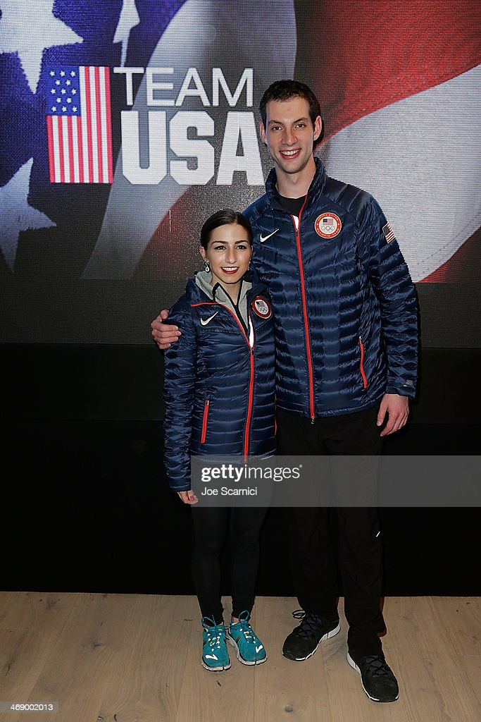 U.S. Olympians <a gi-track='captionPersonalityLinkClicked' href=/galleries/search?phrase=Marissa+Castelli&family=editorial&specificpeople=6702347 ng-click='$event.stopPropagation()'>Marissa Castelli</a> and <a gi-track='captionPersonalityLinkClicked' href=/galleries/search?phrase=Simon+Shnapir&family=editorial&specificpeople=6702348 ng-click='$event.stopPropagation()'>Simon Shnapir</a> visit the USA House in the Olympic Village on February 12, 2014 in Sochi, Russia.