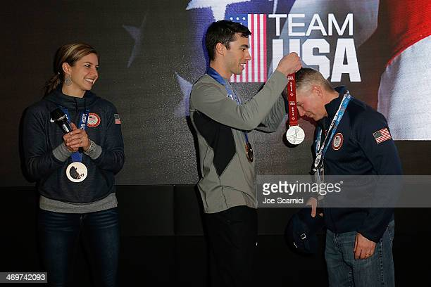 US Olympians Noelle PikusPace and Matthew Antoine and coach Tuffy Latour visit the USA House in the Olympic Village on February 16 2014 in Sochi...