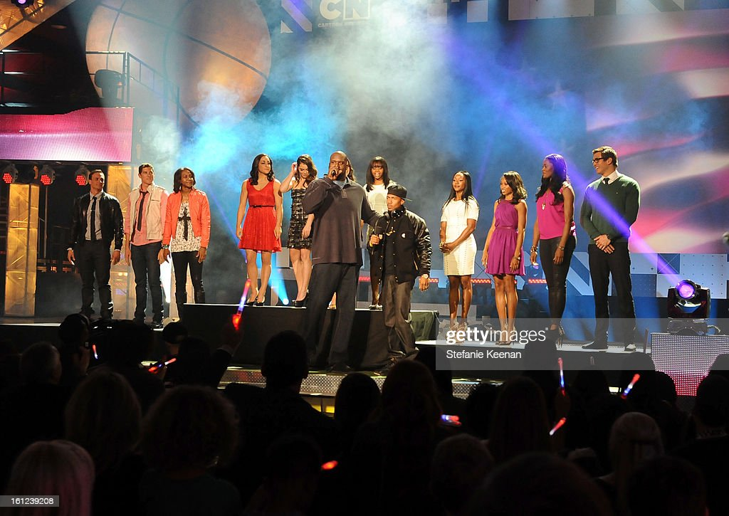 U.S. Olympians Ryan Lochte, Conor Dwyer, Tamika Catchings, Jordyn Wieber, McKayla Maroney, Aly Raisman, Gabrielle Douglas, Carmelita Jeter, Allyson Felix, Swin Cash and Nathan Adrian and hosts Shaquille O'Neal (C), Nick Cannon (C) speak onstage during the Third Annual Hall of Game Awards hosted by Cartoon Network at Barker Hangar on February 9, 2013 in Santa Monica, California. 23270_003_SK_1177.JPG