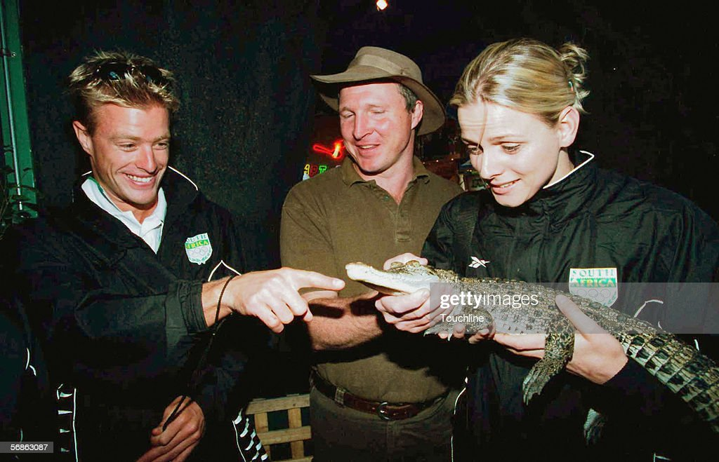 Olympians Simon Thirsk and Charlene Wittstock are shown a crocodile by Anthony Stimson of Australia Wildlife Displays on September 10, 2000 in Sydney, Australia.