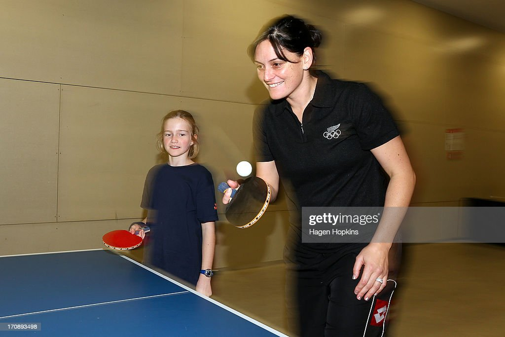 Olympic Ambassador Niniwa Roberts plays a game of table tennis with a child during the launch of the New Zealand Olympic Ambassador Programme at ASB Sports Centre on June 20, 2013 in Wellington, New Zealand.
