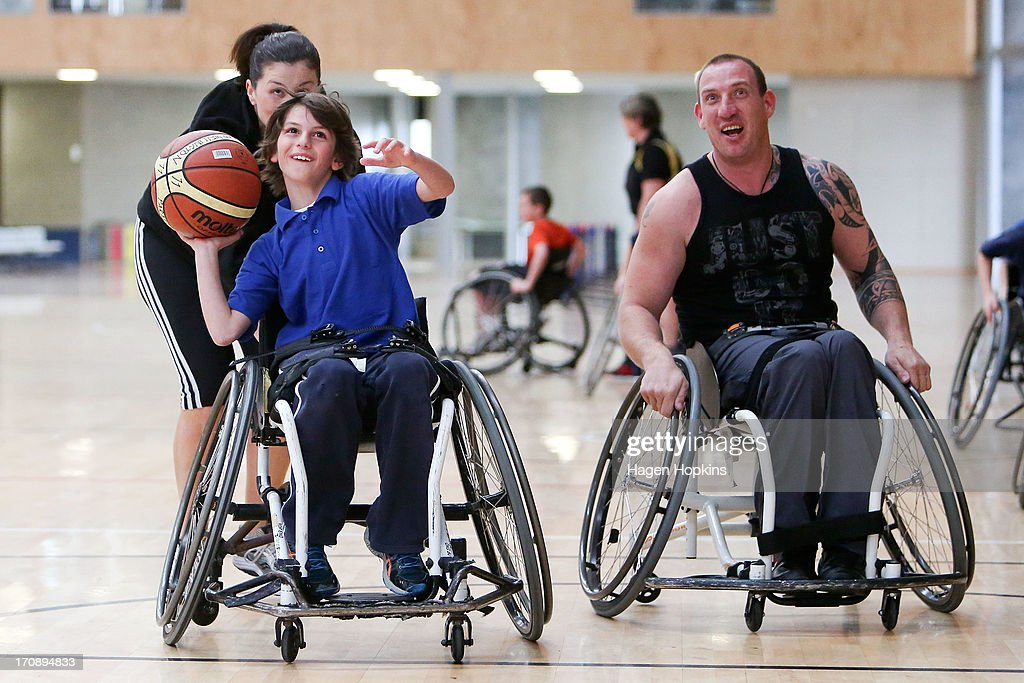 Olympic Ambassador Niniwa Roberts pushes a child during a game of wheelchair basketball at the launch of the New Zealand Olympic Ambassador Programme at ASB Sports Centre on June 20, 2013 in Wellington, New Zealand.