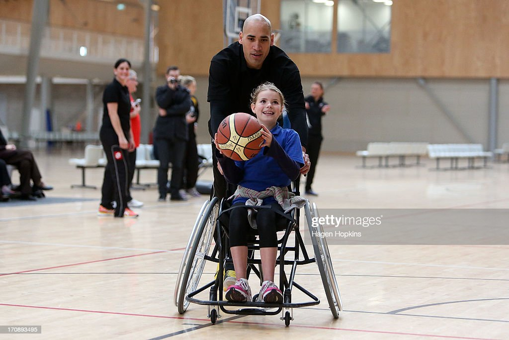 Olympic Ambassador Paora Winitana pushes a child during a game of wheelchair basketball at the launch of the New Zealand Olympic Ambassador Programme at ASB Sports Centre on June 20, 2013 in Wellington, New Zealand.