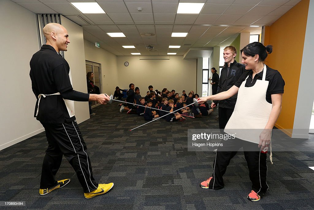 Olympic Ambassadors Paora Winitana and Niniwa Roberts learn to fence during the launch of the New Zealand Olympic Ambassador Programme at ASB Sports Centre on June 20, 2013 in Wellington, New Zealand.