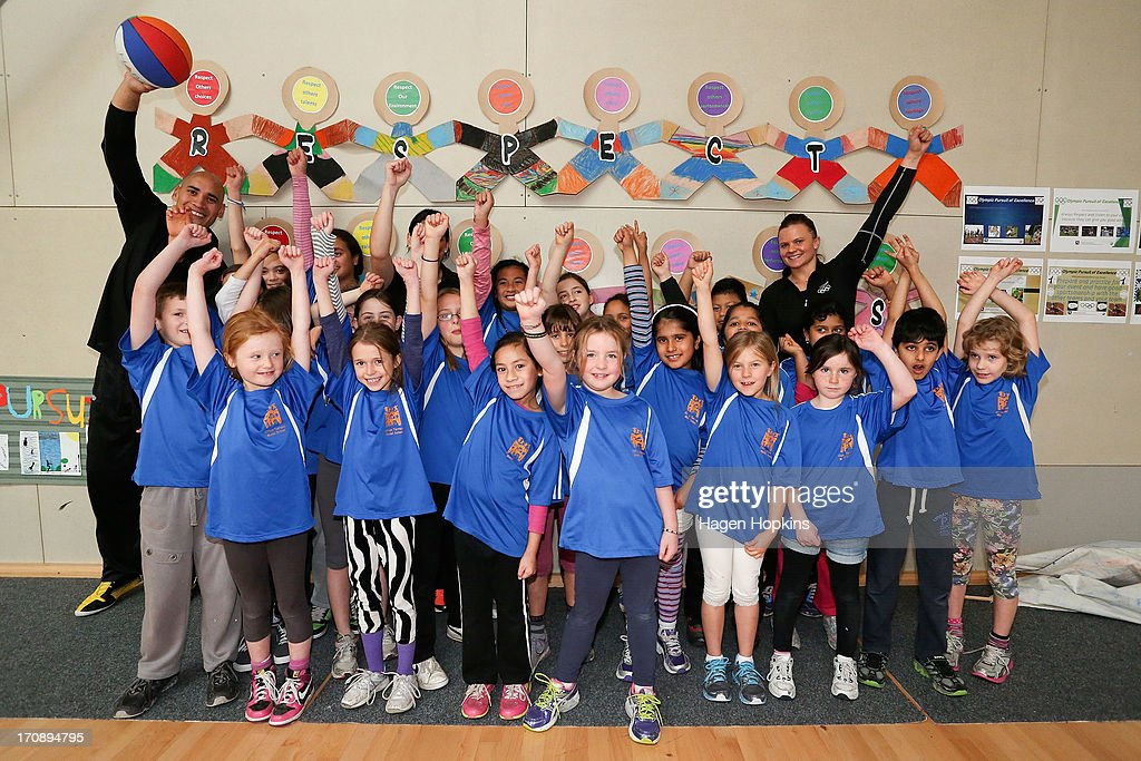 Olympic Ambassadors Paora Winitana(L), Niniwa Roberts and Suzie Bates (R) pose with children from Clifton Terrace Model School during the launch of the New Zealand Olympic Ambassador Programme at ASB Sports Centre on June 20, 2013 in Wellington, New Zealand.