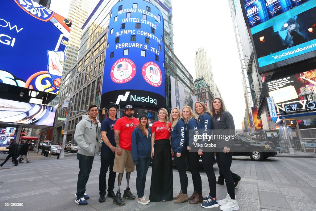 Olympic and Paralympic hopefulls Rico Roman, Joss Christensen, Nikko Landeros, Maddie Bowman, Gracie Gold, Monique Lamoureux, Jocelyne Lamourex, Meghan Duggan and Hilary Knight pose for a photo outside the NASDAQ Stock Market on February 8, 2017 in New York City. Team USA celebrates the one-year countdown to the Olympic Winter Games PyeongChang 2018.