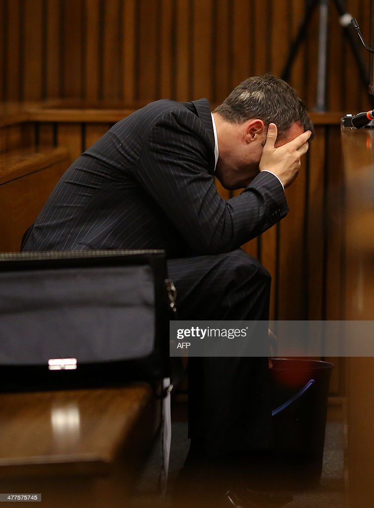 Olympic and Paralympic track star Oscar Pistorius vomits during a hearing on the sixth day of his trial for the 2013 murder of his girlfriend on...