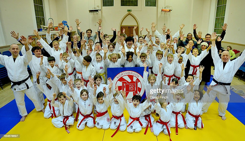 Olympic and World champion, <a gi-track='captionPersonalityLinkClicked' href=/galleries/search?phrase=Maki+Tsukada&family=editorial&specificpeople=2259682 ng-click='$event.stopPropagation()'>Maki Tsukada</a> (centre), celebrates the success of the evening with all the judo coaches and students during the <a gi-track='captionPersonalityLinkClicked' href=/galleries/search?phrase=Maki+Tsukada&family=editorial&specificpeople=2259682 ng-click='$event.stopPropagation()'>Maki Tsukada</a> Fellowship evening at the Northbrook Judo Club, Kingswood Hall, Kingswood Place on March 22, 2013 in Lewisham, London, England..