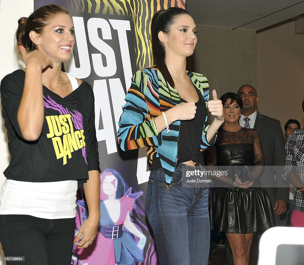 Olympic Athlete Alex Morgan and Kendall Jenner follow dance moves on a video at the Tumbler And Tipsy By Michael Kuluva Spring 2013 fashion show during Style360 at Metropolitan Pavilion on September 11, 2012 in New York City. Kris Jenner, left, also in attendance.