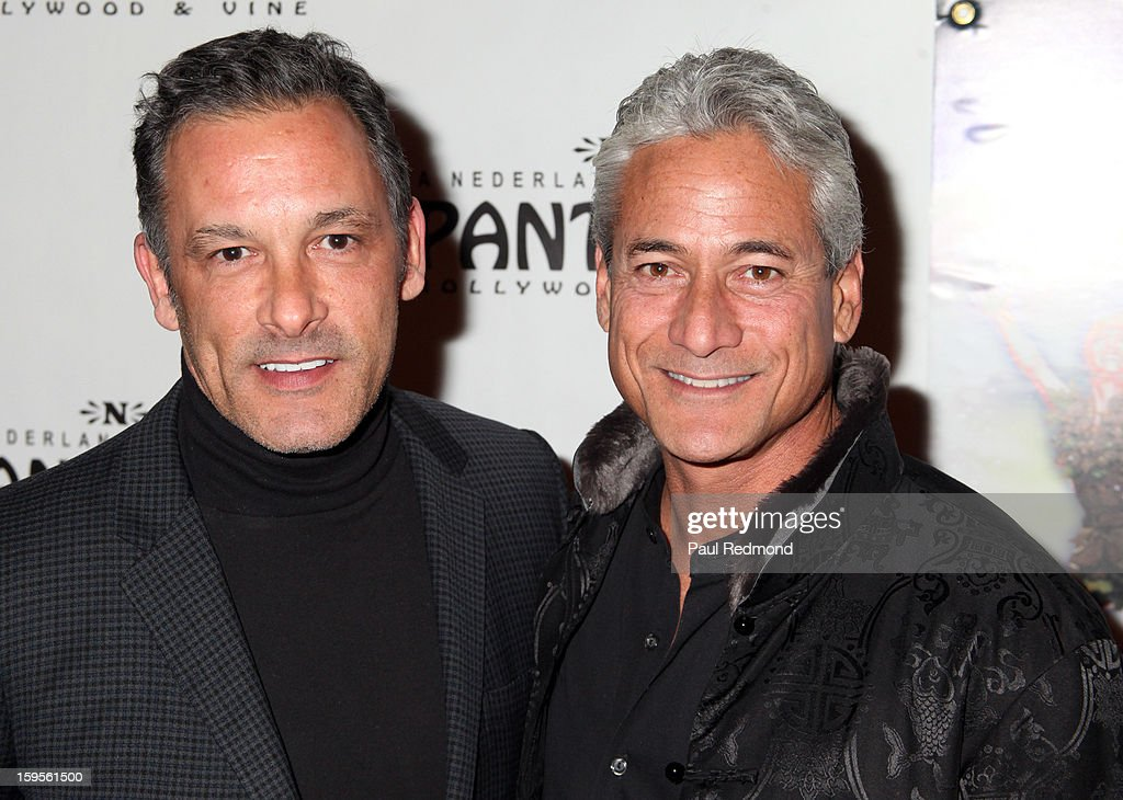 Olympic athlete <a gi-track='captionPersonalityLinkClicked' href=/galleries/search?phrase=Greg+Louganis&family=editorial&specificpeople=217786 ng-click='$event.stopPropagation()'>Greg Louganis</a> (R) and a guest arrive at 'Peter Pan' Los Angeles play opening night at the Pantages Theatre on January 15, 2013 in Hollywood, California.
