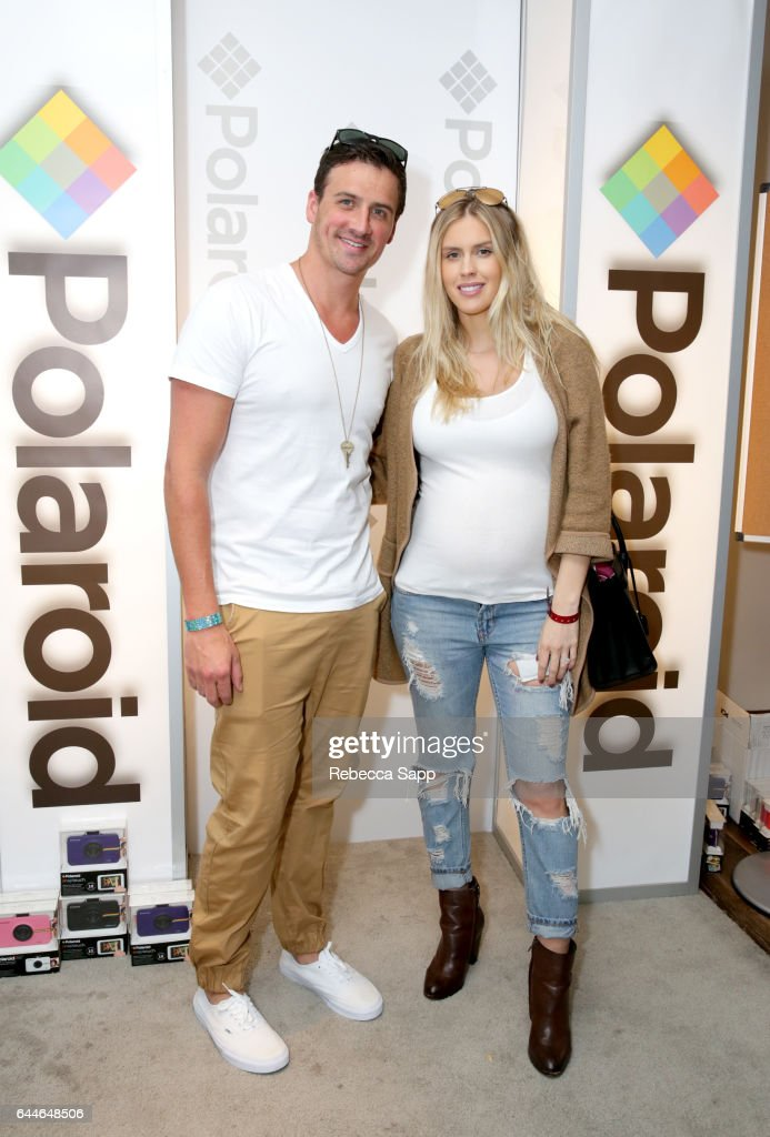 Olympic athlete Ryan Lochte (L) and Kayla Rae Reid attend Kari Feinstein's Pre-Oscar Style Lounge at the Andaz Hotel on February 23, 2017 in Los Angeles, California.