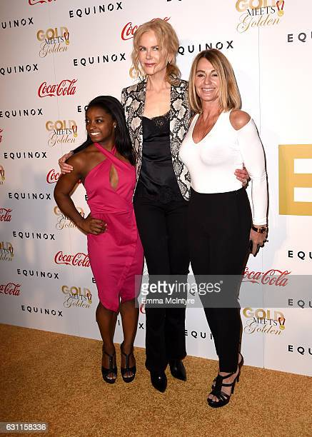 Olympic athlete Simone Biles actress Nicole Kidman and Olympic athlete Nadia Comaneci attend Life is Good at GOLD MEETS GOLDEN Event at Equinox on...