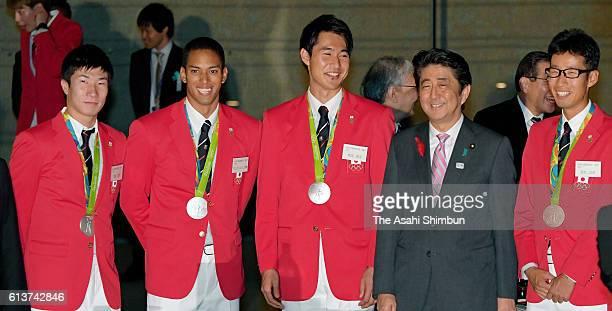 Olympic athletes Yoshihide Kiryu Aska Cambridge Shota Iizuka Japanese Prime Minister Shinzo Abe and Arai Hirooki pose for photographs on October 6...