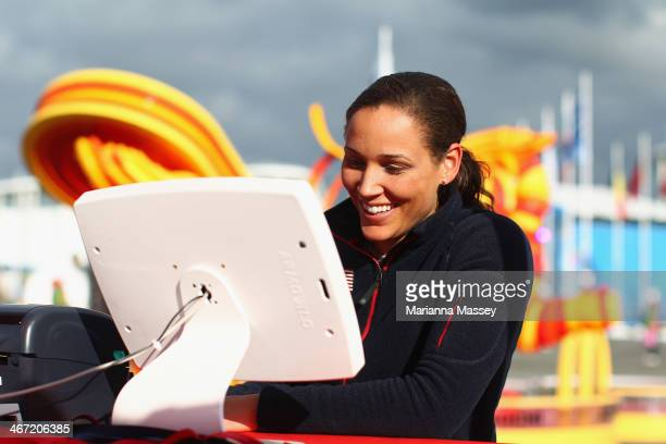 S Olympic bobsledder Lolo Jones stops by McDonald's Cheers To Sochi display in the Athletes Village to read good luck messages from fans ahead of the...