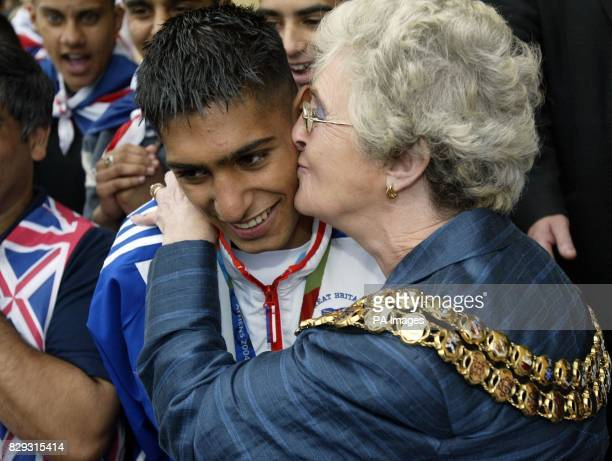 Olympic boxer Amir Khan receives a kiss from the Mayor of Bolton Councillor Howarth as he celebrates winning a silver medal on the steps of Bolton...