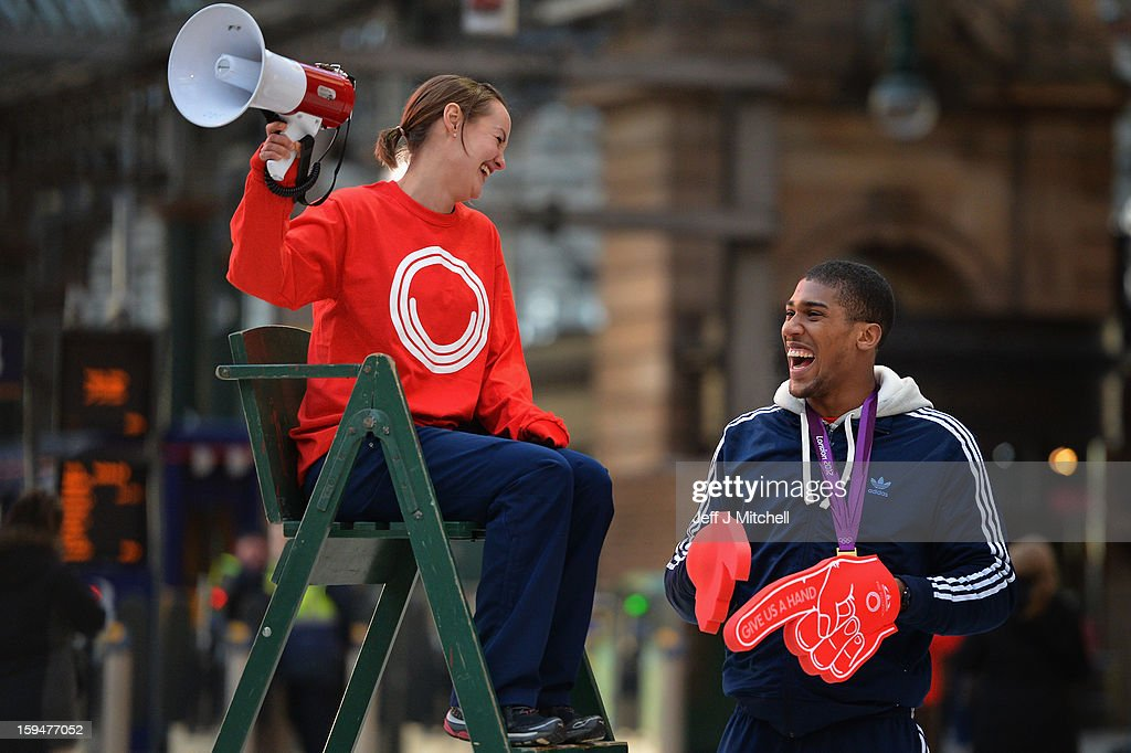 Olympic boxing gold medalist <a gi-track='captionPersonalityLinkClicked' href=/galleries/search?phrase=Anthony+Joshua&family=editorial&specificpeople=8598922 ng-click='$event.stopPropagation()'>Anthony Joshua</a> and badminton player Susan Egelstaff launch the opening of Glasgow 2014 volunteer applications on January 14, 2013 in Glasgow, Scotland. Up to 15,000 people will be needed to help out at Glasgow's 2014 Commonwealth Games at various venues and athletes' village and successful applicants will be invited to interview from April.