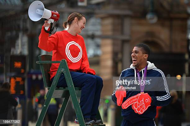 Olympic boxing gold medalist Anthony Joshua and badminton player Susan Egelstaff launch the opening of Glasgow 2014 volunteer applications on January...