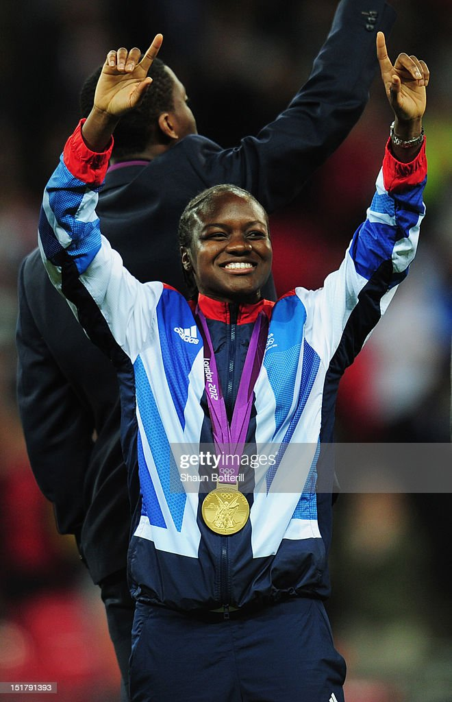 Olympic boxing gold medallist Nicola Adams of Great Britian salutes the crowd at half time during the FIFA 2014 World Cup Group H qualifying match between England and Ukraine at Wembley Stadium on September 11, 2012 in London, England.