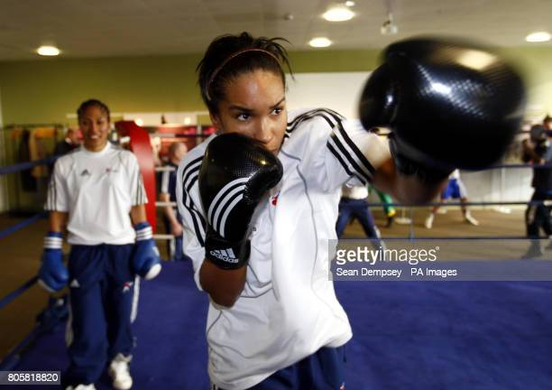 Olympic boxing hopefulls Hannah Beharry British number one in the 48kg weight as Lesley Sackey who fights at Welterweight shadow boxes at the ExCel...