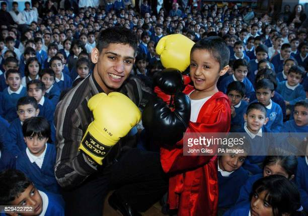 Olympic boxing Silver Medallist Amir Khan has a friendly bout with Mohammed Ali namesake of the famous fighter at Parkinson Lane School in Halifax...