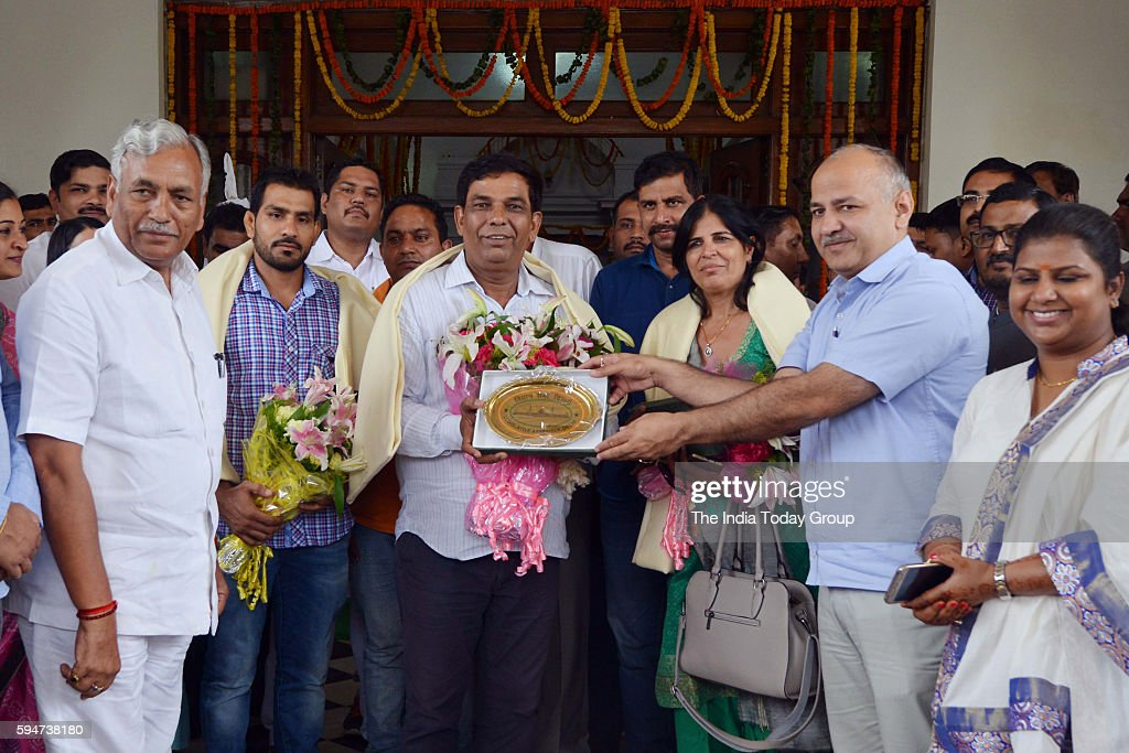 Olympic Bronze Medal Winner Sakshi Malik's parents and her Coach being felicitated by Deputy Chief Minister of Delhi Manish Sisodia at Vidhan Sabha...