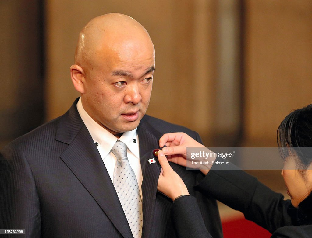 Olympic bronze medalist and newly elected lower house lawmaker Manabu Horii of Liberal Democratic Party let the lawmaker's budge attached at the diet building on December 26, 2012 in Tokyo, Japan. Liberal Democratic Party president Shinzo Abe becomes Japan's 96th prime minister, seventh in six years.