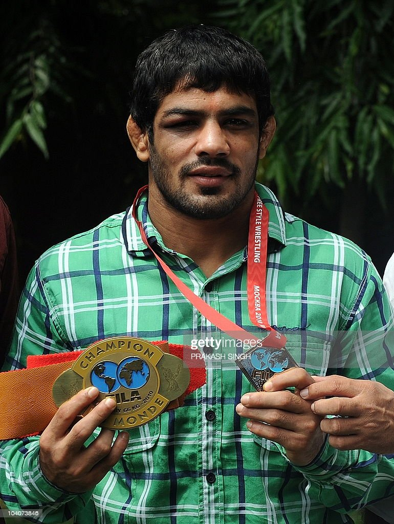 Olympic bronze medalist Indian wrestler <a gi-track='captionPersonalityLinkClicked' href=/galleries/search?phrase=Sushil+Kumar+-+Wrestler&family=editorial&specificpeople=703954 ng-click='$event.stopPropagation()'>Sushil Kumar</a> poses with his medal in New Delhi on September 14, 2010. <a gi-track='captionPersonalityLinkClicked' href=/galleries/search?phrase=Sushil+Kumar+-+Wrestler&family=editorial&specificpeople=703954 ng-click='$event.stopPropagation()'>Sushil Kumar</a> defeated Russian Gogaev to win the 66-kg freestyle title in Moscow on September 12 to become the first Indian to win a world wrestling championship gold medal. AFP PHOTO/Prakash SINGH