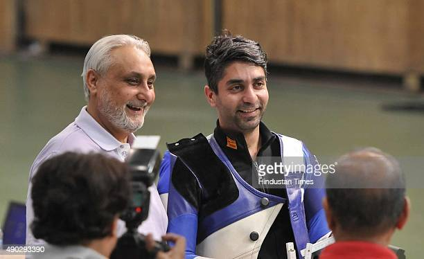 Olympic Champion Abhinav Bindra with his father after winning gold medal during the qualifying round of 10 metre of Asian AirGun Championship at Dr...
