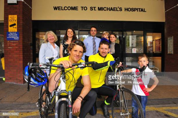 Olympic champion and TV presenter James Cracknell left with fundraiser Jon Furniss second left outside St Michaels Hospital Bristol where they meet...