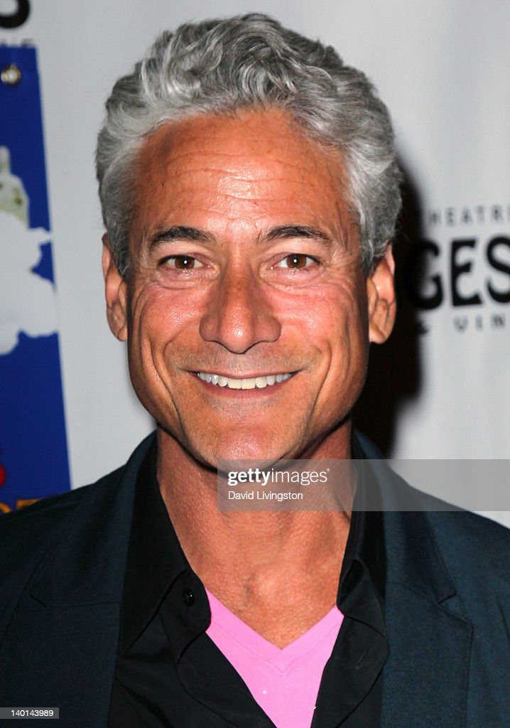 Olympic champion diver <a gi-track='captionPersonalityLinkClicked' href=/galleries/search?phrase=Greg+Louganis&family=editorial&specificpeople=217786 ng-click='$event.stopPropagation()'>Greg Louganis</a> attends the opening night of 'Monty Python's Spamalot' at the Pantages Theatre on February 28, 2012 in Hollywood, California.