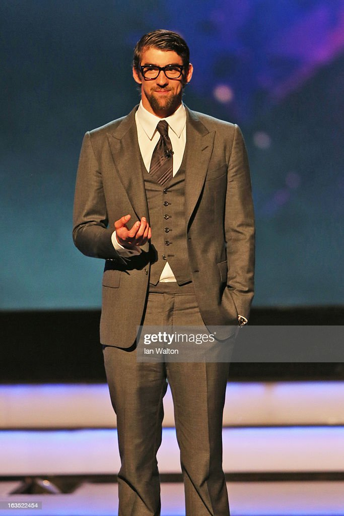 Olympic champion Michael Phelps on stage to announce the winner for 'Laureus World Action Sportsperson of the Year' during the awards show for the 2013 Laureus World Sports Awards at the Theatro Municipal Do Rio de Janeiro on March 11, 2013 in Rio de Janeiro, Brazil. (Photo by Ian Walton/Getty Images For Laureus