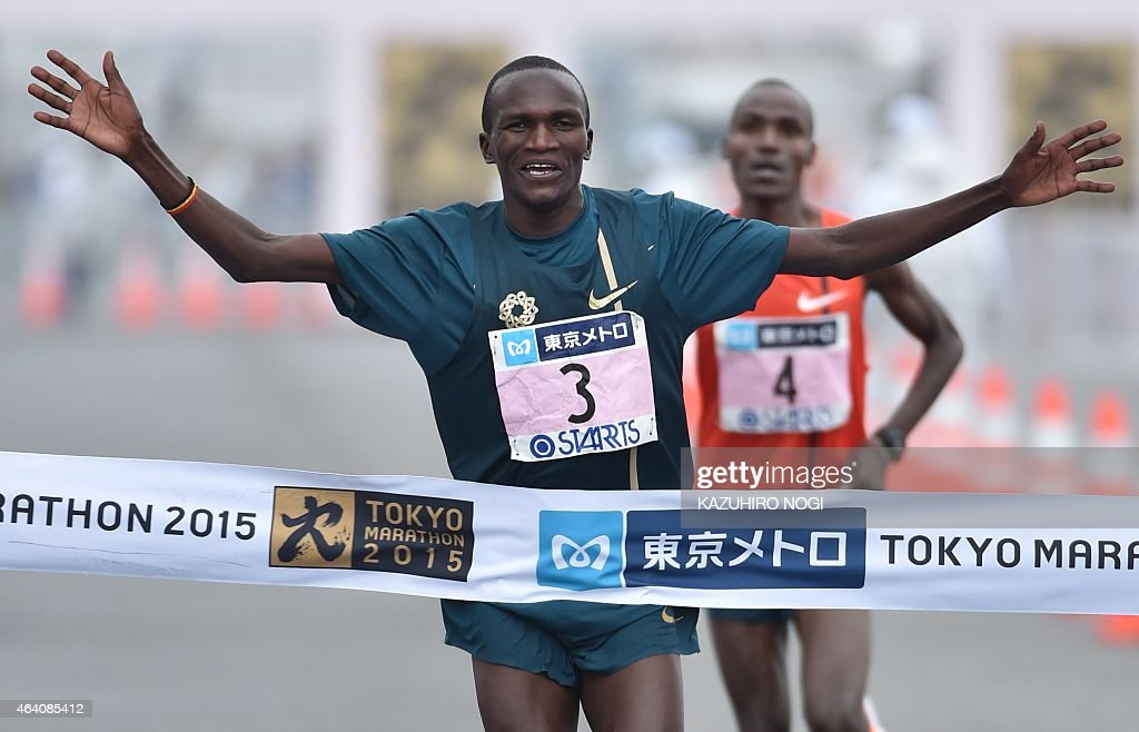 Olympic champion <a gi-track='captionPersonalityLinkClicked' href=/galleries/search?phrase=Stephen+Kiprotich&family=editorial&specificpeople=7069481 ng-click='$event.stopPropagation()'>Stephen Kiprotich</a> of Uganda (front) crosses the finish line as defending champion and race record-holder Dickson Chumba of Kenya follows in the Tokyo Marathon on February 22, 2015. Kiprotich finished in second place with a time of 2 hours, 6 minutes 33 seconds. Ethiopia's Endeshaw Negesse won the competition with a time of 2 hours, 6 minutes flat. AFP PHOTO / KAZUHIRO NOGI