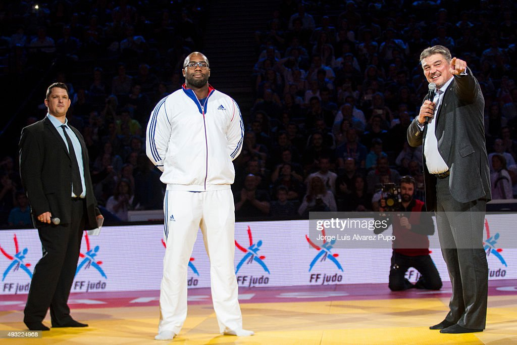 Olympic Champion Teddy Riner of France and former judoka David Douillet of France smile during the Paris Grand Slam 2015 at the Palais Omnisports de Paris-Bercy on October 18, 2015 in Paris, France.