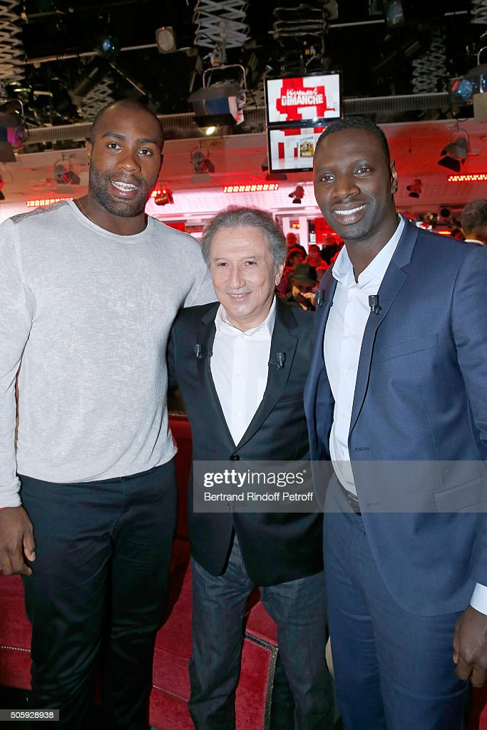 Olympic Champion Teddy Riner, Presenter of the show Michel Drucker and Main guest of the show, Actor Omar Sy attend the 'Vivement Dimanche' French TV Show at Pavillon Gabriel on January 20, 2016 in Paris, France.
