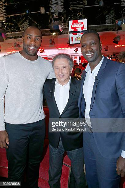 Olympic Champion Teddy Riner Presenter of the show Michel Drucker and Main guest of the show Actor Omar Sy attend the 'Vivement Dimanche' French TV...