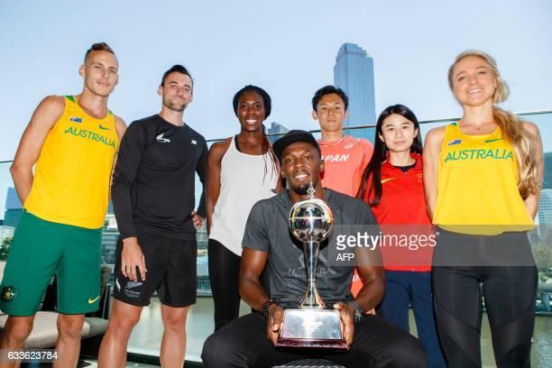 Olympic champion Usain Bolt poses with his team members Ryan Gregson of Australia Matthew Wyatt of New Zealand Christine Ohuruogu of England Wataru...