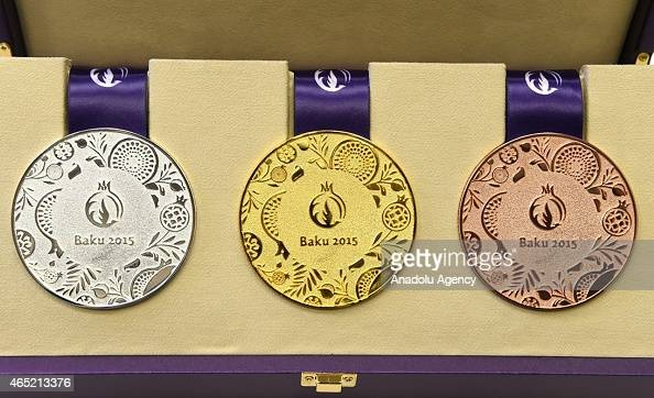 Olympic champions from Azerbaijan Namig Abdullayev Teymur Memmedov and Ilham Zekiyev hold the medal samples those will be given for the future...