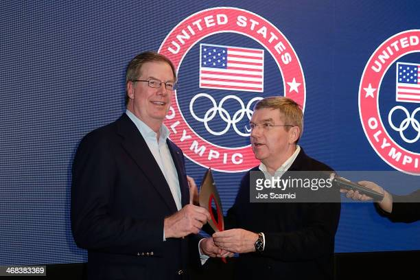 S Olympic Committee chairman Larry Probst and IOC President Thomas Bach attend a gala at the USA House in the Olympic Village on February 10 2014 in...