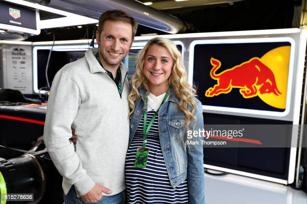 Olympic cycling gold medallist Jason Kenny and his Olympic cycling gold medallist wife Laura pose for a photo at the Red Bull Racing garage before...