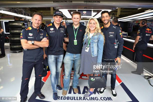 Olympic cycling gold medallist Jason Kenny and his Olympic cycling gold medallist wife Laura pose for a photo with Red Bull Racing Team Principal...