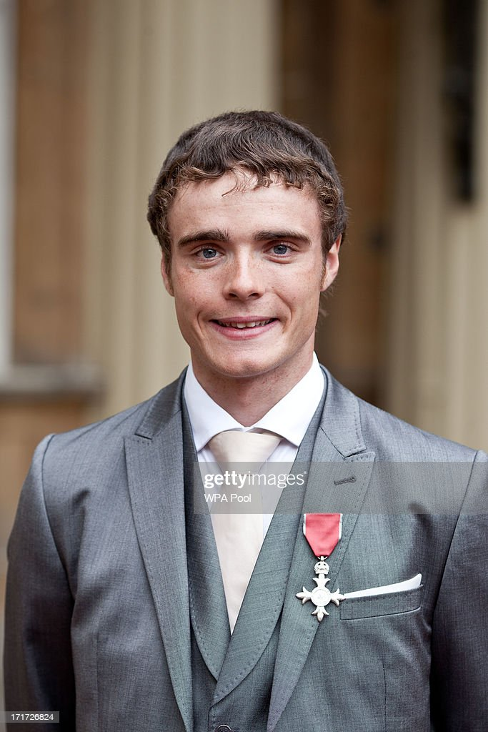 Olympic cyclist <a gi-track='captionPersonalityLinkClicked' href=/galleries/search?phrase=Steven+Burke&family=editorial&specificpeople=3304118 ng-click='$event.stopPropagation()'>Steven Burke</a> with his MBE for services to cycling after he received the award from Prince Charles, Prince of Wales during an Investiture ceremony at Buckingham Palace on June 28, 2013 in London, England. Mo Farah will receive an CBE for services to Athletics.
