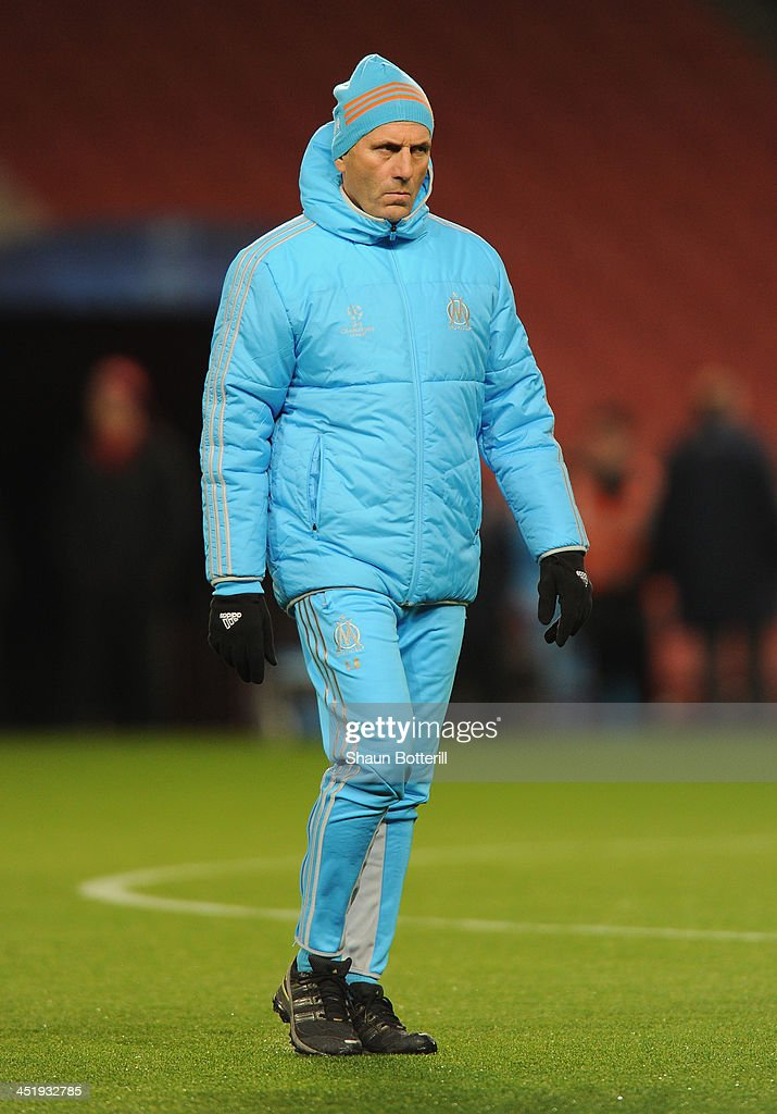 Olympic de Marseille coach <a gi-track='captionPersonalityLinkClicked' href=/galleries/search?phrase=Elie+Baup&family=editorial&specificpeople=536928 ng-click='$event.stopPropagation()'>Elie Baup</a> during a training session at Emirates Stadium on November 25, 2013 in London, England.