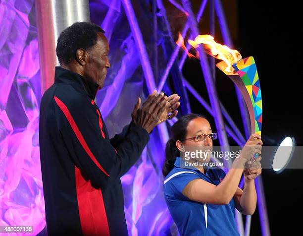 Olympic decathlon champion Rafer Johnson and Destiny Sanchez attend the opening ceremony of the Special Olympics World Games Los Angeles 2015 at the...