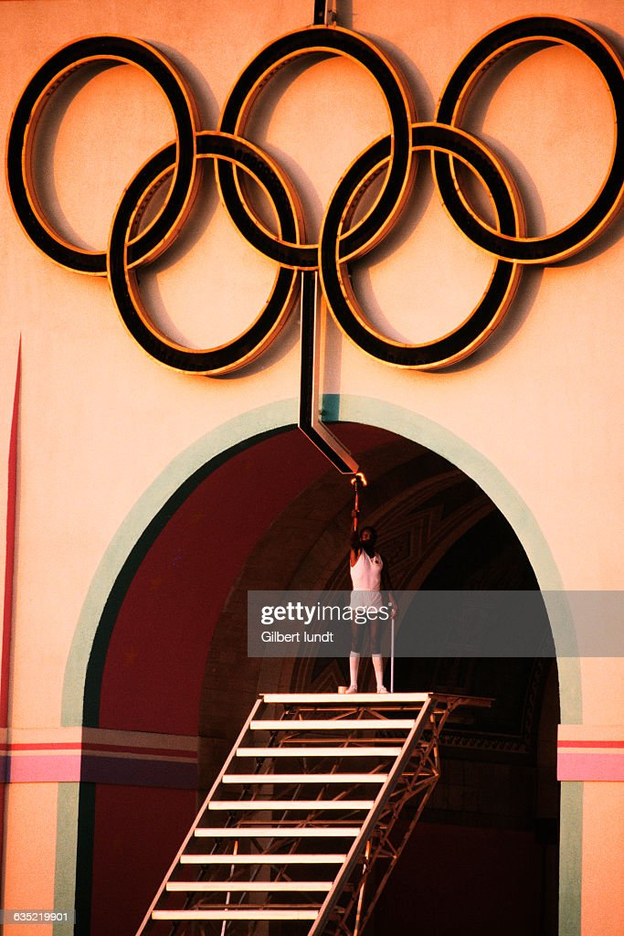 Olympic decathlon gold medal winner Rafer Johnson stands atop a stairway to light the Olympic rings which will, in turn, light the Olympic Flame at the Opening Ceremonies of the 1984 Summer Olympics.