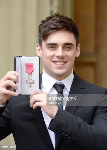 Olympic diver Chris Mears poses after they were awarded an MBE by the Prince of Wales during an Investiture ceremony at Buckingham Palace on May 19...
