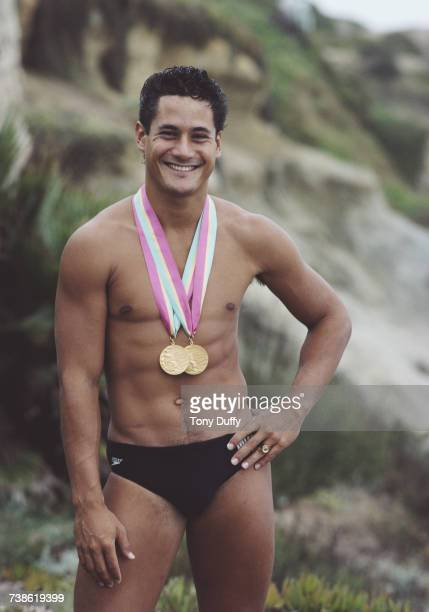 Olympic diver Greg Louganis of the United States poses for a portrait with his two Olympic Gold medals on 1 September 1984 in Los Angeles California...