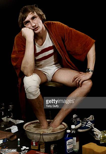 Olympic European and Commonwealth Games medallist Alan Pascoe of Great Britain poses for a portrait soaking his feet in a bowl of water on 30th June...