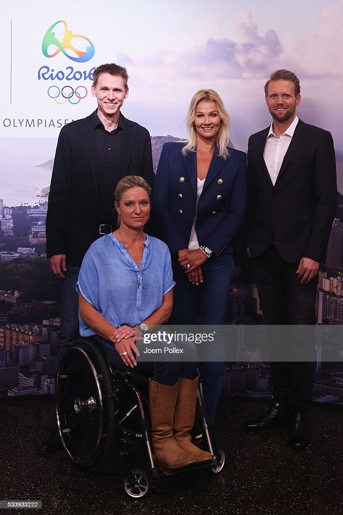 Olympic experts Frank Busemann (L), Kirsten Bruhn (2nd L), Fransiska van Almsick (2nd R) and Julius Brink (R) pose during a photocall prior to the ARD and ZDF Olympics 2016 Press Conference at Empire Riverside Hotel on May 24, 2016 in Hamburg, Germany.